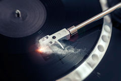 Vinyl laying on a record player - scratching the surface Stock Image
