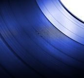 Vinyl LP close-up blue background Royalty Free Stock Image