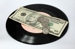 Vinyl and money. Royalty Free Stock Images