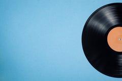 Vinyl musical disc on blue background; Stock Photo