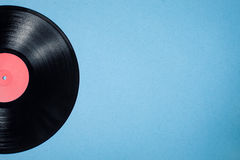 Vinyl musical disc on blue background; Stock Photos