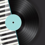Vinyl with piano keys background Royalty Free Stock Image