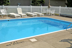 Vinyl picket fencing and swining pool. Image of white vinyl picket fence and swimming pool Stock Photo