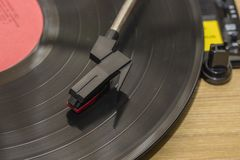 Vinyl player with copy space. Needle on rotating black vinyl plate. Included gramophone and rotating plate. royalty free stock photography