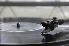 Vinyl player. A vinyl player with a vinyl disc is running Royalty Free Stock Image
