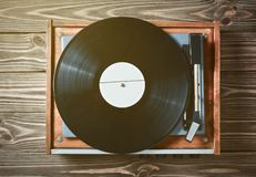 Vinyl player with plates on a wooden table. Entertainment 70s. Listen to music. Top view stock photo