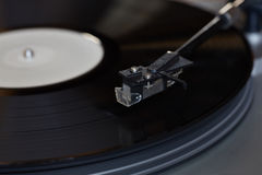 Vinyl player. The rotating disk. Head close-up. Royalty Free Stock Images