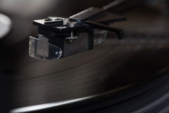Vinyl player. The rotating disk. Head close-up. Royalty Free Stock Photo