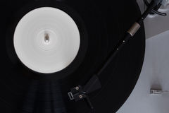 Vinyl player. The rotating disk. Head close-up. Royalty Free Stock Photography
