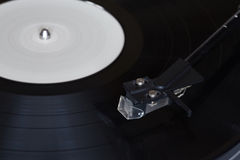 Vinyl player. The rotating disk. Head close-up. Stock Image