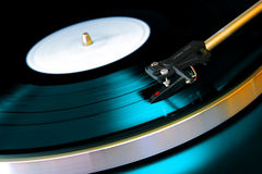 Vinyl Record. Close up on a vinyl record playing on a turntable stock images