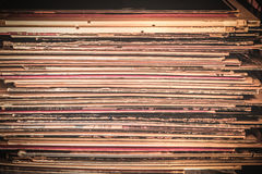 Vinyl Record Album Texture. Spines of Vinyl record album covers in stack Stock Images