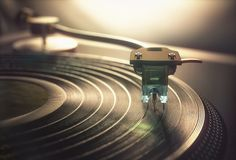 Vinyl Record Retro Vintage. Vinyl record being played on old retro vintage disc jockey device royalty free stock photos