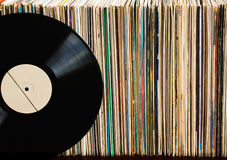 Vinyl record on a collection of albums. Vinyl record with copy space in front of a collection of albums, vintage process royalty free stock image
