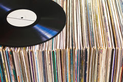 Vinyl record on a collection of albums Royalty Free Stock Image
