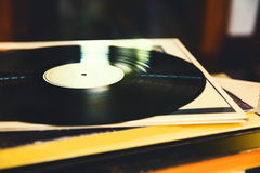 Vinyl record and a collection of albums Royalty Free Stock Photo