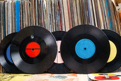 Vinyl record with copy space in front of a collection albums dummy titles, vintage process Stock Photo