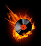 Vinyl Record Disc in Flames. Vector Vinyl Record Disc in Flames on black background. Hot hits Royalty Free Stock Photo