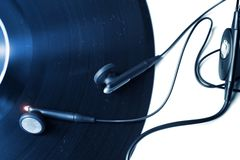 Vinyl record with earphones Stock Photo
