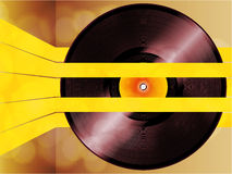 Vinyl record glowing on yellow stripes Royalty Free Stock Photos