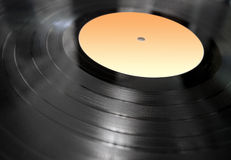 Vinyl record lying in perspective. Music phonograph record made of vinyl Royalty Free Stock Image