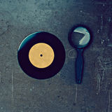 Vinyl record and magnifier Royalty Free Stock Photography