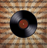 Vinyl record on the music note paper Stock Photos