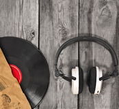 Vinyl  record, paper cover and headphones Stock Photos