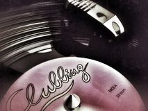 Vinyl Record on Player. Vinyl record on a turntable with a label that says Clubbing going around and round stock illustration