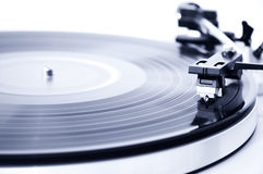 Vinyl record player. Spinning record player. Focus on the needle head Stock Image