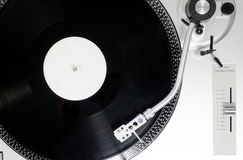 Vinyl record on the player. Analog Stereo Turntable White Vinyl Record Player white Head shell Cartridge Stock Photos