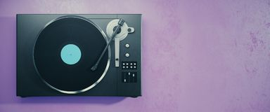 Vinyl record player on purple background Stock Photography