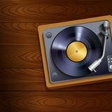 Vinyl record player on wooden background Royalty Free Stock Photography