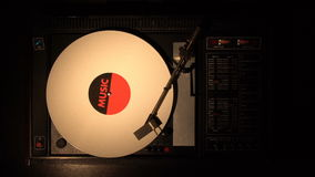 Vinyl record on the pleer. Plays a song from an old turntable. stock video