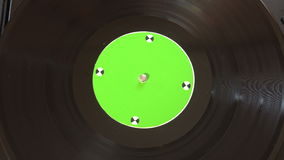 Vinyl record pleer. Plays song from an old turntable 4k top view. stock footage