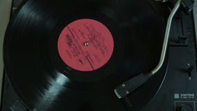 Vinyl record spinning in the gramophone. Close-up. Vinyl record  spinning in the gramophone. Close-up stock footage