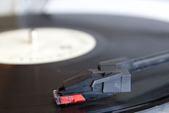 Vinyl record spinning on turntable Stock Photos