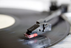 Vinyl record spinning on turntable Royalty Free Stock Photography