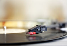 Vinyl record spinning on turntable Royalty Free Stock Images