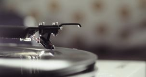 Vinyl record spinning on a turntable with arm and needle, closeup side view, blur. stock video