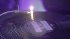 Vinyl record spinning on turntable. Audio mixer. Night club atmosphere. Stock footage stock footage