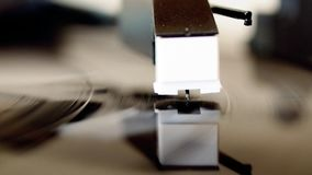 Vinyl record spinning. On a turntable, focus on needle stock video footage