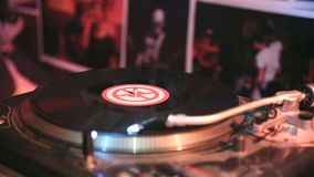 Vinyl record spinning used in night club. Vinyl record spinning in DJ console stock footage