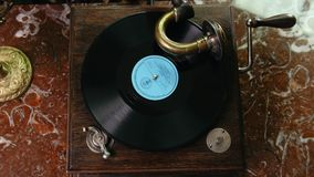 Vinyl record spinning on vintage old gramophone - top view. Music stock footage