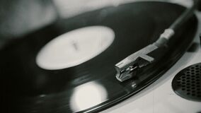 Vinyl record spinning on vintage phonograph, old music playing at retro party. Stock footage stock video footage