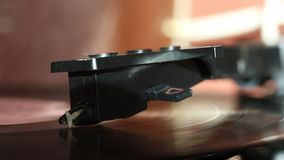 Vinyl record spins on the player. The needle head of the player moves along the track. Everything is covered with dust stock video