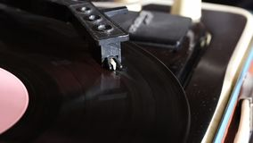 Vinyl record spins on the player. The tracks are visible, the pickup with the needle moves along the track stock video