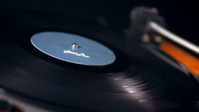 Vinyl record starts spinning with a stylus on it. 4K stock footage