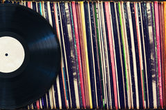 Free Vinyl Record With Copy Space In Front Of A Collection Of Albums (dummy Titles) Royalty Free Stock Photo - 48555685