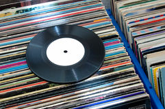 Vinyl Records. 45rpm vinyl record on a collection of vinyls Royalty Free Stock Photography
